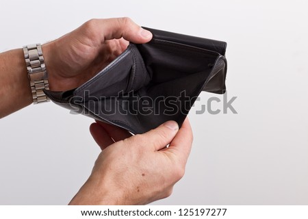 hands opening an empty wallet over white - stock photo
