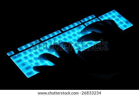 hands over luminous keyboard - stock photo