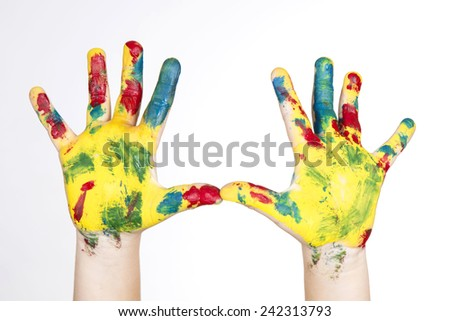hands painted in colorful paint - stock photo
