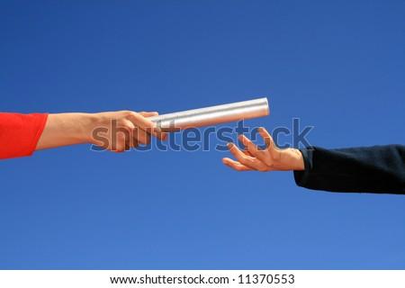 hands passing the baton - stock photo