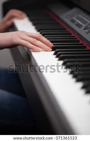 Hands playing piano close up  - stock photo