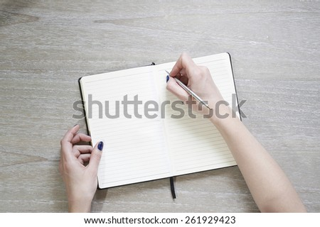 Hands printing text using keyboard - stock photo
