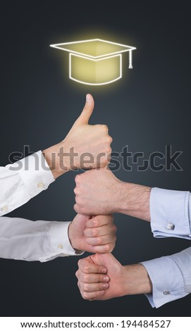 Hands, project work, graduation hat. Dark background. - stock photo