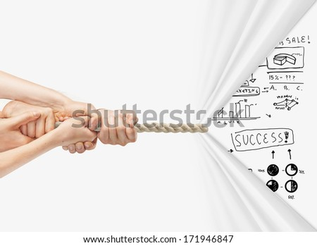hands pulling rope and drawing  business concept - stock photo