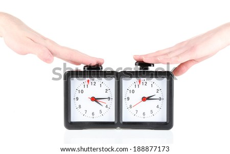 Hands pushing chess clock, isolated on white - stock photo