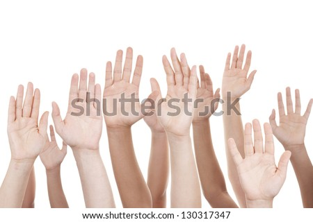 Hands raised - stock photo