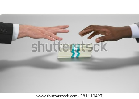 Hands reaching for money. Who's first. Duelists or fools. Money is power. - stock photo