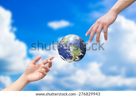hands reaching the world for heal together, save the world concept ,Elements of this image furnished by NASA - stock photo