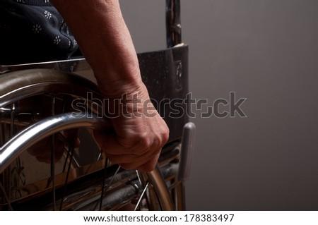 Hands Senior in wheelchair - stock photo
