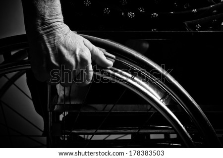 Hands Senior in wheelchair - stock photo
