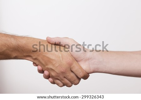 Hands shake - stock photo