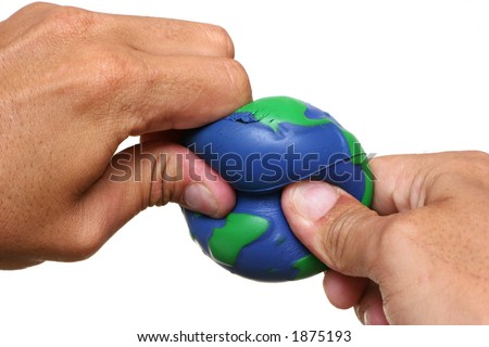 Hands squeezing Earth over a white background - stock photo