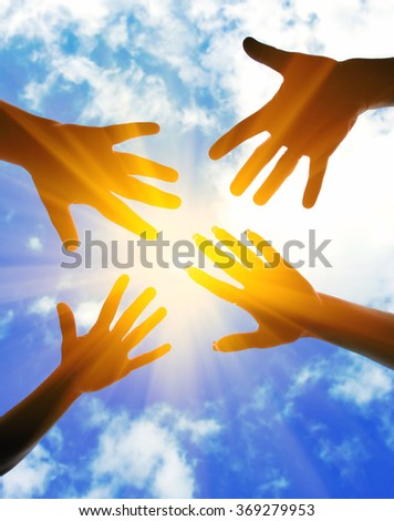 Hands symbol of union touch white light - stock photo