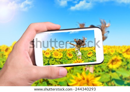 Hands taking photo girl with smartphone - stock photo