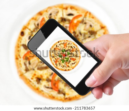 Hands taking photo pizza with smartphone  - stock photo