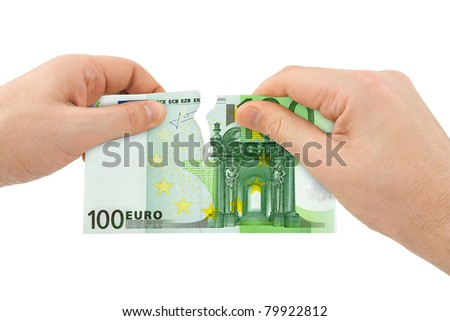 Hands tear money isolated on white background - stock photo