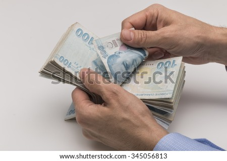 Hands to count the Turkish Lira - stock photo