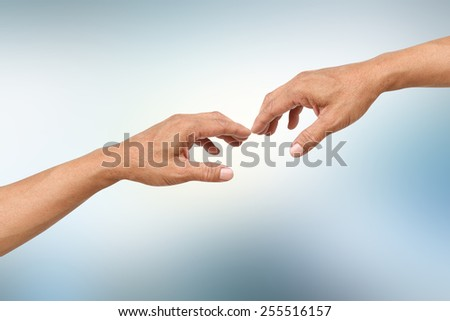 hands touching on blur background with hands path - stock photo