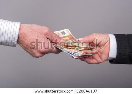 Hands transferring money - stock photo