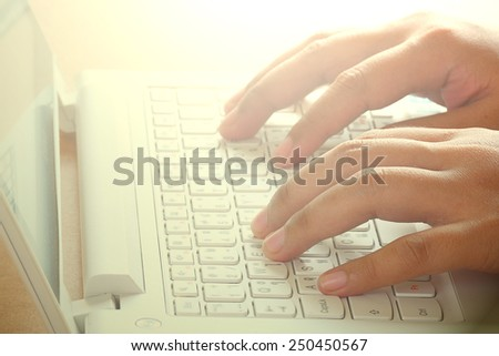 Hands typing on computer keyboard. - stock photo