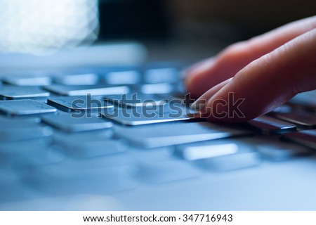 Hands typing on laptop computer keyboard close up - stock photo