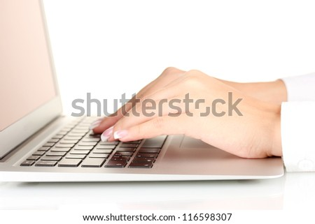 Hands typing on laptop keyboard close up - stock photo