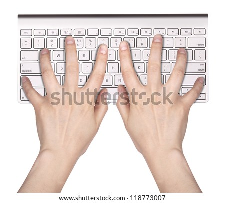 Hands typing on the remote wireless computer keyboard in an office at a workplace isolated on a white background - stock photo