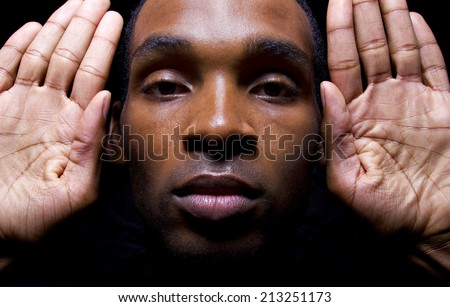 hands up don't shoot gesture by a black male - stock photo