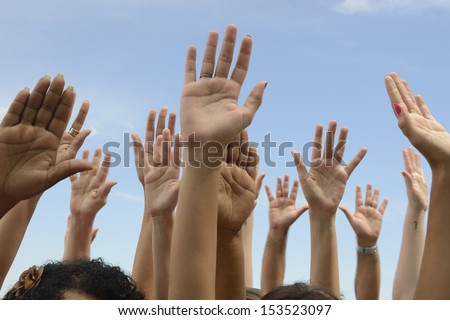 Hands Up: Group of people lifting hands - stock photo