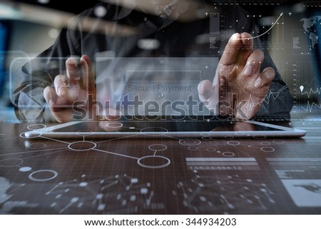 """hands using digital pro tablet with """"Secure payment"""" on the screen as Online shopping concept - stock photo"""
