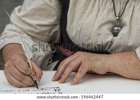 hands while writing a letter with a plume - stock photo
