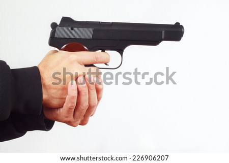 Hands with army handgun on a white background - stock photo
