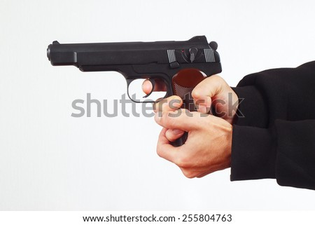 Hands with automatic gun on a white background - stock photo