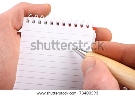 Hands with ballpen notepad on isolated white background. - stock photo