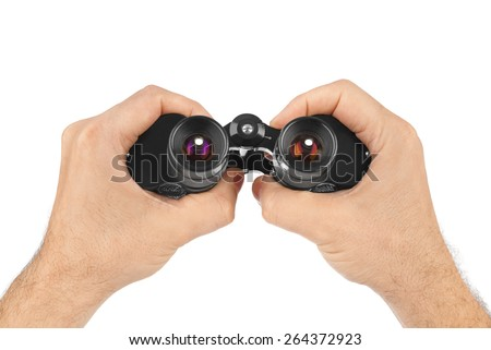 Hands with binoculars isolated on white background - stock photo