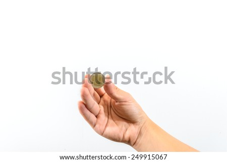 Hands with coin - stock photo