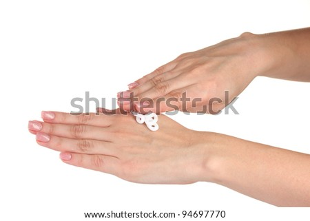 Hands with cream isolated on white - stock photo