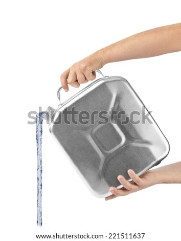 Hands with metal jerrycan and jet isolated on white background - stock photo