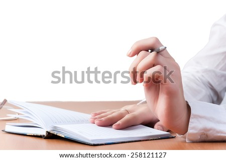 Hands with pen of reflected business lady over organizer - stock photo
