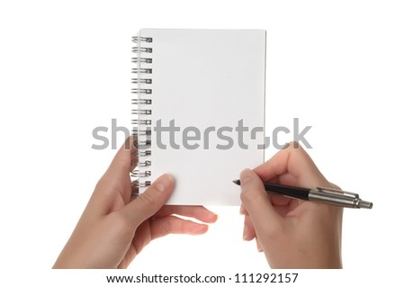 Hands with pen over note paper isolated on white background - stock photo