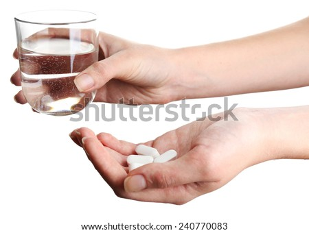 Hands with pills and glass of water isolated on white - stock photo