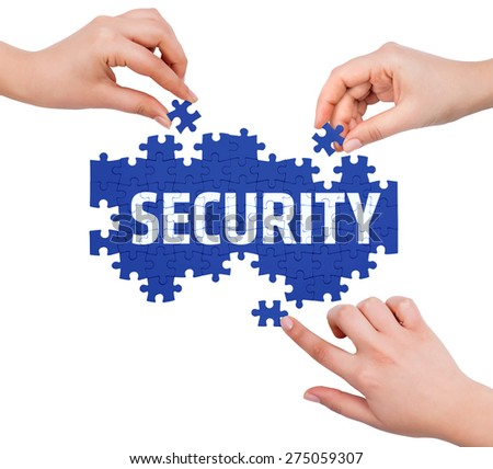 Hands with puzzle making SECURITY word  isolated on white  - stock photo