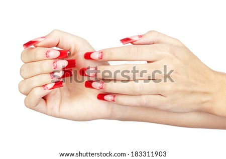 Hands with red french acrylic nails manicure and painting isolated  white background - stock photo