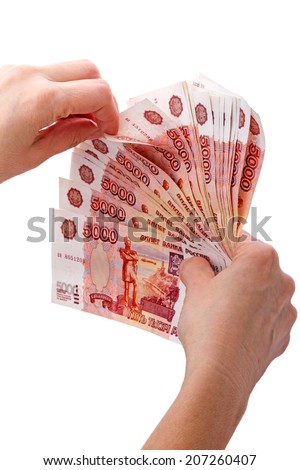 Hands with Russian paper money 5000 rubles isolated on white background - stock photo