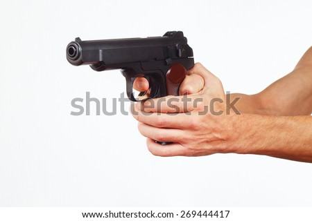 Hands with semi-automatic gun on a white background - stock photo