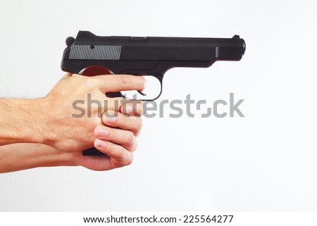 Hands with semi-automatic handgun on a white background - stock photo
