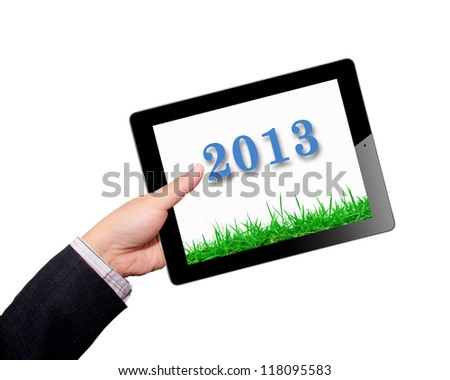 Hands with tablet computer screen grass in 2013 year. Isolated on white background. - stock photo