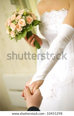 Hands with the wedding rings - stock photo
