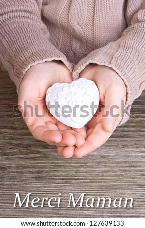 Hands with white heart and lettering mother`s day/mother`s day/heart - stock photo