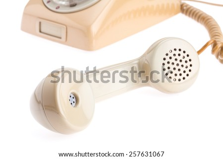 handset of antique telephone placed on isolate white background - stock photo